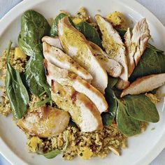 Grilled chicken with curried couscous, spinach & mango