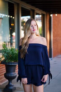 Navy off the shoulder romper, off the shoulder, romper, festival outfit, long sleeve romper, silk romper, strappy sandal, coachella, balayage hair.
