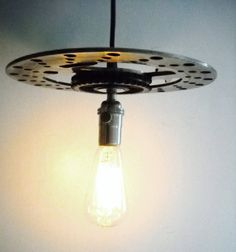 Industrial Pendant Light Hanging Vintage Metal Steampunk Off Road Motorcycle Gears with Edison Bulb. $89.95, via Etsy.
