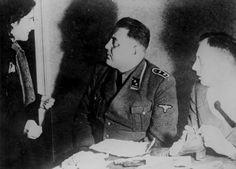 Warsaw, Poland, German policemen interrogating a Jewish girl in the ghetto, 1940-1943.