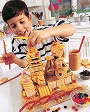 It may be fun to make castles for a princess party.  I'll have to do this as a craft and post the results... if we have time.  http://familyfun.go.com/crafts/cracker-castles-666578/