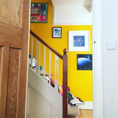 Bright yellow wall on our staircase.  #summer #spring #brights #hallways #entrance #stairs #familyhome