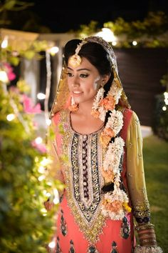 South Asian desi bride. Pakistani bride. Pakistani mehndi outfit. Flowers in hair. Photo by:Mutahir Mahmood