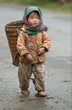 Nepal, young child carrying a load