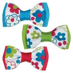 Brighten up your day with these Aria Sweetie Dog Barrettes.        Bright flowers on bows.      Made of Polyester ribbon.      Metal clip closure.    Why We Love It:    Bright and lively, these bows are sure to add a pop of color to any doggie design. Bows coordinate with apparel items sold separately. Each ribbon bow has a barrette backing. Match with Gingham Sweeties Dress Sold Separately.