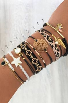 Several ibiza bracelets of Mint15 in a color combination of black, white and gold.