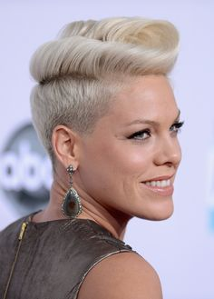 Pink is the queen of the modern pompadour hairstyle. She is known for wearing it edgy but rocks a softer pompadour here.