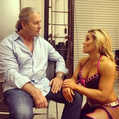 Bret the Hitman Hart and Natalya. I just love how she always gives him a hug when he's out.