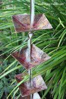 Rain chains, instead of a downspout - i would love the sound. bet I could DIY, shards of glass bottles...