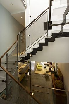 check out the cool industrial staircase rail