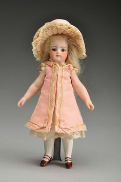 Simon & Halbig all-bisque Mignonette doll made for the French trade, 7 1/4 inches tall, est. $2,000-$3,000.