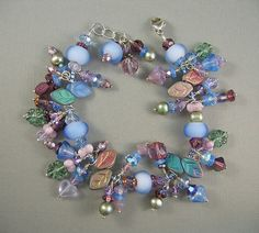Items similar to Blue Floral Glass Bead and Lampwork Glass Charm Bracelet on Etsy Glass Jewelry, Glass Beads, Unique Jewelry, Jewellery, Beaded Bracelets, Charm Bracelets, Charmed, Handmade Gifts, Beautiful Things