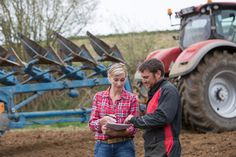 saleswoman try to sell new tractor to farmer New Tractor, Farmer, Tractors, Monster Trucks, Couple Photos, Couples, Image, Things To Sell, Silver