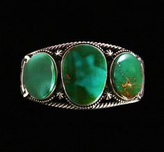 Terry Martinez RARE Gem Grade Royston Turquoise Bracelet | eBay  Hand made by award winning Navajo artist, Terry Martinez, this amazing piece is set with rare gem grade natural Royston turquoise from Nevada. The cabochons include exquisite hues of dark green with chocolate-brown matrix. The bracelet features exceptional design as well with both large and small droplets used as a border to the stones.   $1250