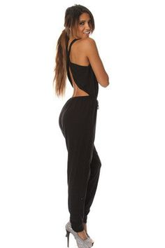 Turn heads in thiscrossed back jumpsuit. Fits true to size. Model is wearing a small.