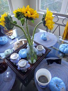 "Our ""Friendsgiving"" table setting. #UNC #thanksgiving #carolina #tablesetting #sunflowers #blue #pumpkins"
