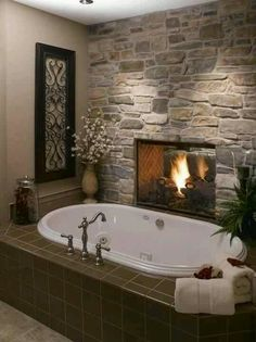 Not a big fan of tubs without showers, but that is pretty sweet looking with the fireplace