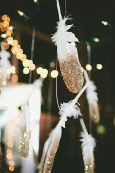 Another example of the glitter feathers, hanging them up around the room!