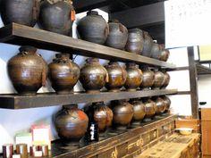 Japanese tea vendor...love those pots!