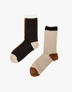 Mismatched color block socks from Hansel from Basel. Features a distinctly modernist color block scheme with a perfect autumn color palette and ribbed cuffs. • Mismatching color block crew socks • Ribbed ankles • Cotton/Nylon • Made in Korea