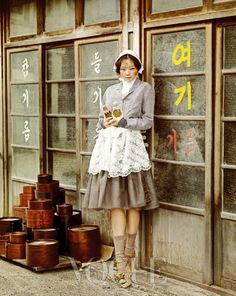Vogue Korea.  So hip. The photographer captured a picture that mirrors pictures taken in korea in the 20th century. We can tell that it's taken in the 21st century because of the color photography and modern cut skirt.