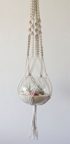 macrame has so many applications - use it to display plants, precious ornaments or candles