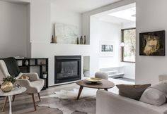 Living room decorated in clear ground tones and with a fireplace