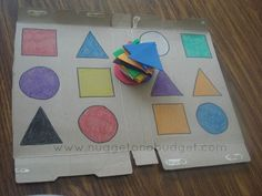 Color and shape match game ~ look closely... thrifty tip: use a cereal box (or similar) to make the board