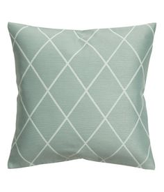 Dusky green. Cushion cover with a jacquard-weave pattern at front, solid-color back in woven cotton fabric. Concealed zip.
