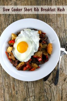 This Slow Cooker Short Rib Breakfast Hash cooks overnight so you can wake up to a hearty, delicious breakfast!