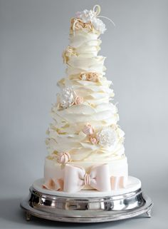 Elegant Cake with Sculpted Flowers and Layers of Petals