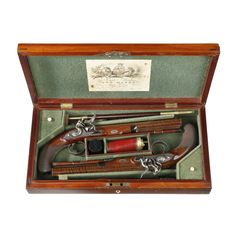 A CASED PAIR OF FLINTLOCK DUELLING PISTOLS BY JOSEPH MANTON, SERIAL NOS. 6585 FOR 1815 SIZE: Case dimensions: Height 7 x Width 49 x Depth 22.5 cm / 2.7 x 19.3 x 8.9 inches ITEM REF: 1095 PRICE BRACKET: £50,000 to £100,000
