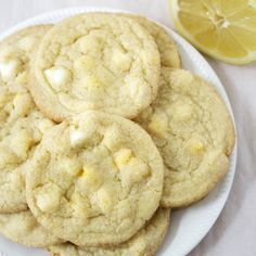 Lemon White Chocolate Chip Cookies – melt in your mouth white chocolate chips baked into a delicious lemon cake batter cookie.