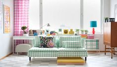 From a Sweedish design company callled:  BEMZ.  They make all kinds of covers for IKEA furniture.  Things that stand out a bit.  See how sweet this is!  Söderhamn 3 seater sofa cover - Big Waves Aqua/White