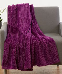 """Magenta Popcorn Fleece Throw. . ...  Hotel Elements. . ...  $14.99 $24.99  . 50"""" x 60""""  . : Product Description:  Snuggle up with popcorn, a movie and this ultracozy fleece throw made in a solid color to complement your home.      50'' x 60''  .     Polyester  .     Machine wash  .     Imported"""