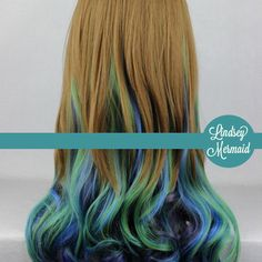 """+ Lovely brown hair that ombres into green and blue peacock inspired colors.    +Length: 26""""  +Weight: 400 grams  +Hair Type: Synthetic [Heat Resistant. Can Be Styled Using Low Heat]   +Stretch Adjustable, One Size Fits All Wig Cap    Custom Make Time: 2-4 Weeks  *NOTE*: Rush Orders Available For..."""