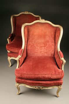Pair of decorated hand carved French Louis XV style wingback chairs. Circa 1930. #antique #chairs