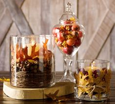 Pinner said: Fall is already arriving in the craft stores...start early and give these cheap and fun candle holders...find the glass at goodwill stores...and dollar stores...ivory candles can be purchased at Michaels really cheap...