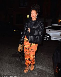 Matchy matchy: For her late night feast, Rihanna donned a pair of unmissable orange camo pants which matched perfectly with a pair of her own Fenty X Puma Creepers