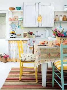 Wouldn't go this rustic, but love the use of color and layers of fabric and texture.