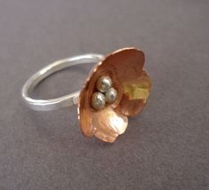 Looks like a cold connection?  Copper and Sterling Silver Ring Flower