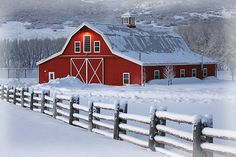 Beautiful red barn in the snow.