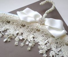 Luv-  beautiful venice  lace on padded hanger with satin bow and pearl accent