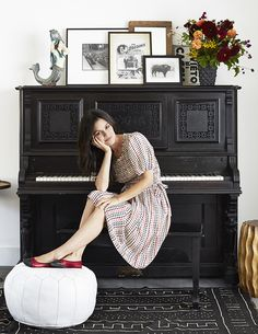 Bohemian Eclectic Vintage Specialty Room: Rachel Bilson at her antique piano topped with a mermaid sculpture and a collection of framed art.