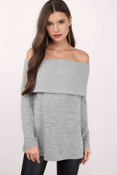 Stand out from the crowd in the Go On Off Shoulder Sweater. Featuring a romantic off shoulder neckline and back slit. Pair with skinny jeans and ankle booties.