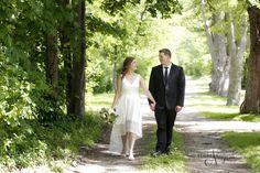 A romantic walk down lover's lane at The Little Log Wedding Chapel in Niagara