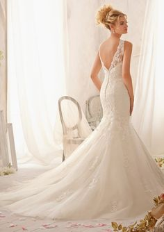 Bridal Gown From Mori Lee By Madeline Gardner Dress Style 2610 Delicately Embroidered Lace Appliqués on Net
