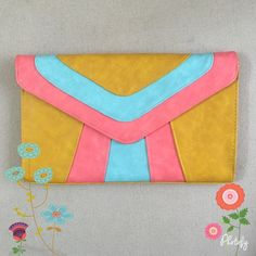 ☀️SALE☀️ Yellow, Pink, Blue Casual Clutch Super trendy pink, blue, and yellow gold clutch ☺️ Comes with gold strap that can be used for cross body or just on the shoulder Perfect for dressing up any occasion  Mild signs of wear on corners, otherwise good condition ☀️   NO TRADES  POSH Rules Only   Customized Bundle Discounts   Offers please use offer button below  Urban Expressions Bags Clutches & Wristlets