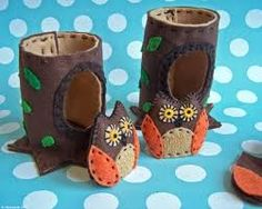 Felt owls & tree trunks, but I like the idea of making tree trunks to go with the owl craft. could make from large cardboard container (like oatmeal container)