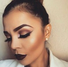 Them eyebrows are total brow game. Cheek bones and dark purple lipstick. Makeup game onpoint